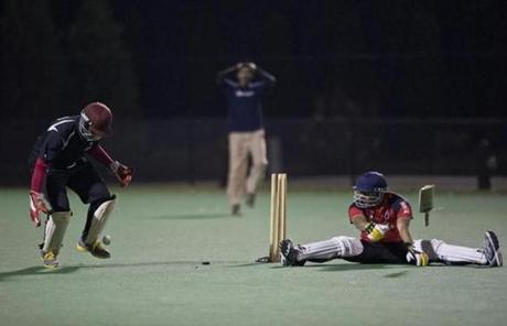 Northeastern's Mihir Shah (right) watched as Harvard's wicket keeper Norris Guscott tried to keep the ball in front of him.